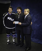 <strong>Tyler Johnson joined Lightning owner Jeff Vinik to present Dr. Randy Feldman with a check for $50,000