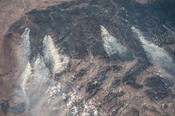 <strong>Crew members aboard the space station during Expedition 36 in 2013 captured this image of smoke plumes from wildfires burning in central Idaho. Credits: NASA</strong>