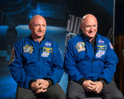 <strong>Expedition 45/46 Commander, retired astronaut Scott Kelly (right) along with his brother, retired astronaut Mark Kelly (left) speak to media about the Twins Study and One-Year Mission.</strong>