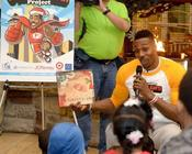 <strong>Dwight Howard of the Atlanta Hawks reads to children attending a special event as part of his &quot;3-Point Santa Project,&quot; focusing on children's literacy as a special way to commemorate the holidays.</strong>