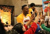<strong>Atlanta Hawks' Dwight Howard reacts to indoor snow with children attending a special event as part of his &quot;3-Point Santa Project&quot; focusing on children's literacy as a way to commemorate the holidays.</strong>