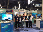 The AquaWorld team poses for a photo during the DEMA Show in Las Vegas.