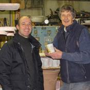 <strong>Master potter Michael Roche presenting the 3,000th Culchie Mug to Ken Byrne</strong>