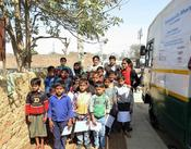 <strong>The slum children of the 'Education on Wheels' program with Meera Satpathy, the founder and chairperson of Sukarya.</strong>