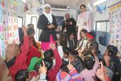 <strong>The slum children with their teachers inside the converted mobile classroom.</strong>