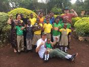 <strong>L: Rita Langeland, Founder of Treasures of Africa (TOA), Rob Nelson, Tate Nelson with the Orphans of TOA.</strong>
