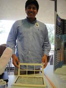 <strong>Eugenio Martinez holds a prototype of a lint catcher that was 3-D printed for the HUNCH program when he was a senior at Conroe High School in Texas.  Credits: NASA</strong>