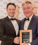 Jose Simon (L), Texas Chiropractic Association District 11 Director, presents Doctor of the Year award to Houston Chiropractor Gregory Johnson at the recently-held TCA annual convention. (Photo: TCA)