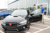 <strong>Jerry Ortega (right) handing Brandon James (left) the keys to his new 2017 Civic Type R, delivered by Wilde East Towne Honda.</strong>