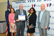 <strong>Synensys CEO Stephen Powell (third from left) accepts a certificate of achievement after completing the Veteran Institute Procurement (VIP) GROW Program on June 22.</strong>