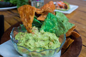 <strong>Homemade Guacamole served with crispy jalapeño and chipotle chips