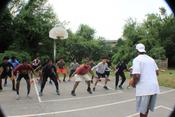 The 13th Man Founder, Davon Kelly leads participants in basketball drills during Day 2 of the empowerment boot camp.