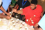 <strong>The 13th Man Summer Classic included team building activities, such as working in teams to build a marshmallows and spaghetti structure.</strong>