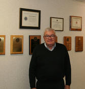 <strong>Bob Thompson in front of his many awards.</strong>
