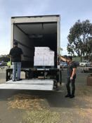 <strong>Offloading water, food and supplies to the volunteers at the Del Mar Fairgrounds</strong>