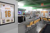 <strong>Tennessee Volunteers man cave furnished with TeamSportsGift.com sports team accessories.</strong>
