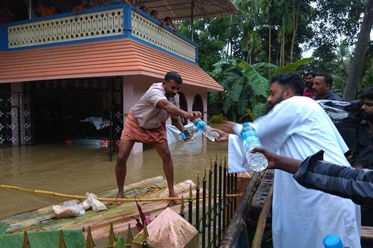 GFA-supported Workers Use Boats for Rescue and Relief Efforts in Flood-Hit Kerala