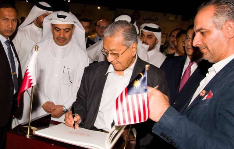 Mahathir visits Qatar's dairy company Baladna